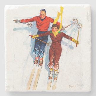 Esquí alpino de los pares posavasos de piedra
