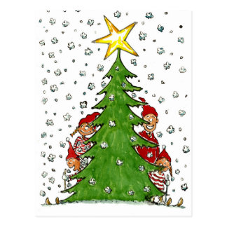 Esquí cerca del árbol de navidad tarjetas postales
