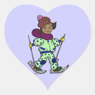 Esquí de la nieve del chica pegatina en forma de corazón