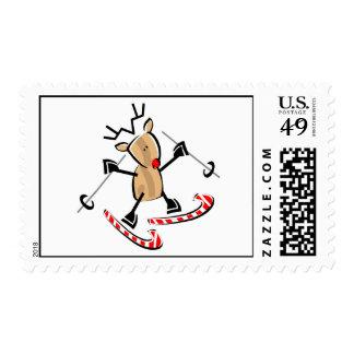 esquí de Rudolph en los bastones camdy Timbre Postal