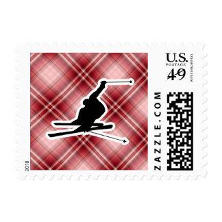 Esquí rojo de la nieve de la tela escocesa timbres postales
