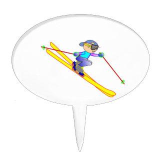 Esquiador amarillo y azul del dibujo animado que decoraciones para tartas