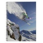 Esquiador en aire note book