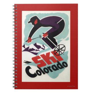 Esquiador negro y púrpura vestido libreta