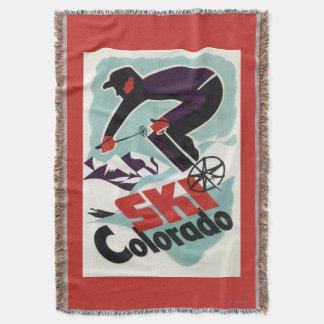 Esquiador negro y púrpura vestido manta