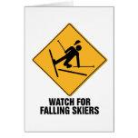 Esquiadores que caen felicitacion