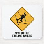 Esquiadores que caen tapetes de ratones