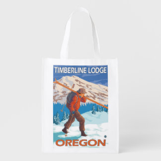 Esquís de la nieve del esquiador que llevan - casa bolsa reutilizable