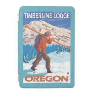 Esquís de la nieve del esquiador que llevan - casa cubierta de iPad mini