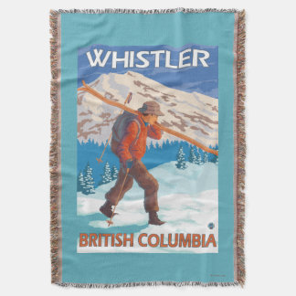 Esquís de la nieve del esquiador que llevan - manta