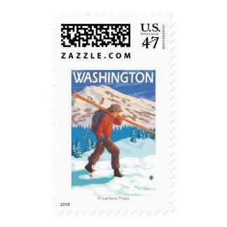 Esquís de la nieve del esquiador que llevan - sellos