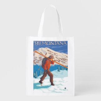 Esquís de la nieve del esquiador que llevan - bolsa reutilizable