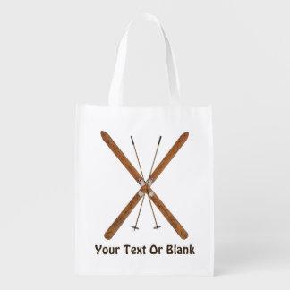 Esquís y postes a campo través bolsas de la compra
