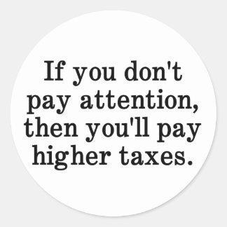 Esta es la razón por la cual sus impuestos son más pegatina redonda