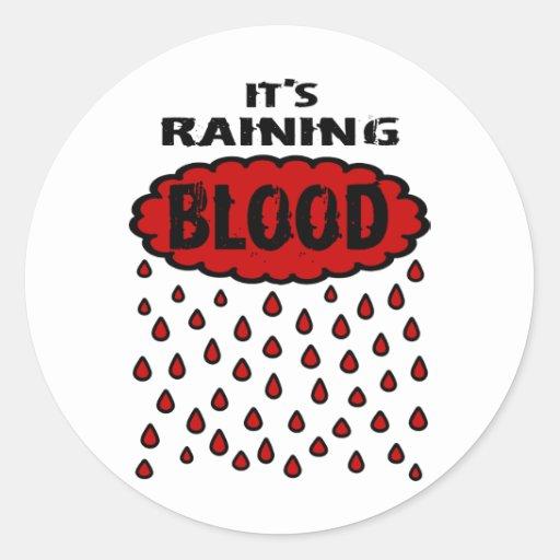 Está lloviendo sangre con la nube de la sangre y l pegatina redonda