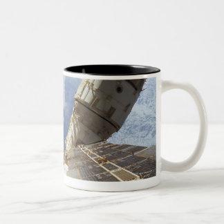 Estación espacial en la órbita 8 tazas de café