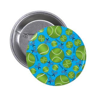 Estafas y redes de las pelotas de tenis del azul pin