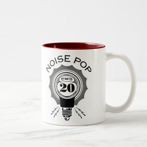 Estallido 20 del ruido taza de café de dos colores