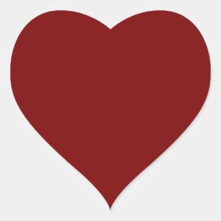 Estallido rojo de rubíes sólido del color pegatina en forma de corazón