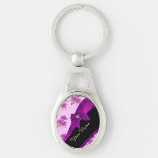 Estampado de flores púrpura de color de malva llavero plateado ovalado