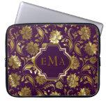 Estampado de flores púrpura y metálico del oro funda portátil