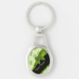 Estampado de plores floral del vintage verde llavero plateado ovalado