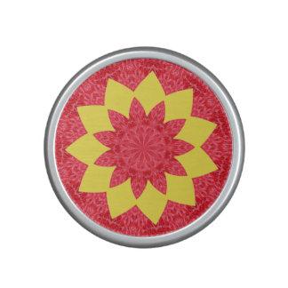 Estampado de plores geométrico rojo y amarillo con altavoz con bluetooth