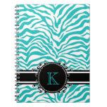 Estampado de zebra azul enrrollado con el monogram libro de apuntes con espiral