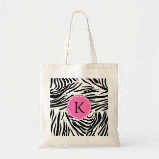 Estampado de zebra blanco y negro del monograma co bolsa lienzo