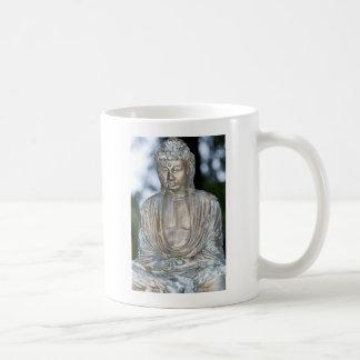 Estatua de Buda del oro Taza