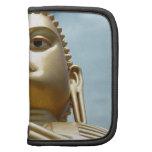 Estatua de oro de Buda del zen Planificadores