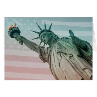 Estatua of Liberty en front of american Flag