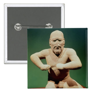 Estatuilla de un luchador pin