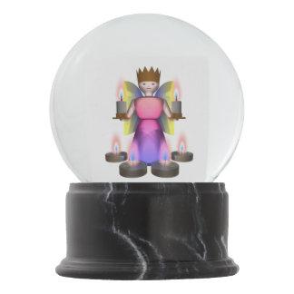 estatuilla del ángel con las velas bola de nieve