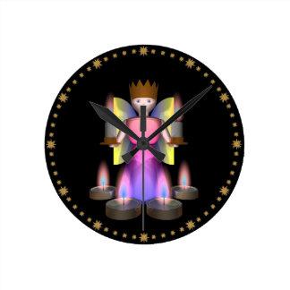 estatuilla del ángel con las velas reloj redondo mediano