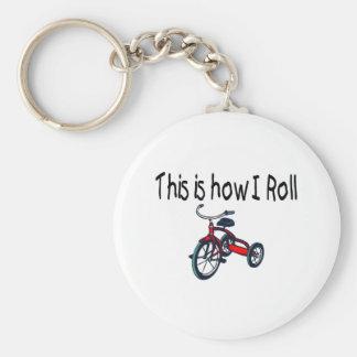 Éste es cómo ruedo el triciclo rojo llavero