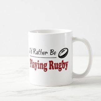 Esté jugando bastante a rugbi tazas de café