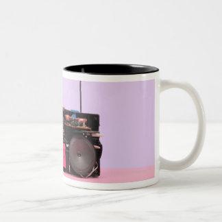 Estéreo portátil desmontado taza de café