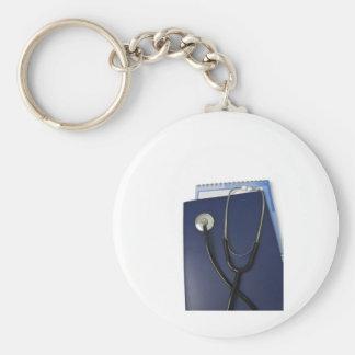 estetoscopio médico en carpeta azul llavero redondo tipo pin