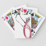 Estetoscopio rosado barajas de cartas