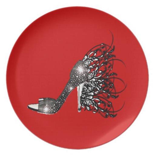 Estilete negro chispeante en rojo platos