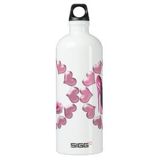 Estilete rosado, subió y botella de la libertad de