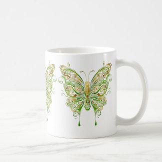 Estilo colorido del tatuaje de la mariposa taza