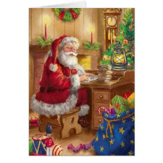 Estilo Papá Noel del vintage que trabaja en su Tarjeta De Felicitación
