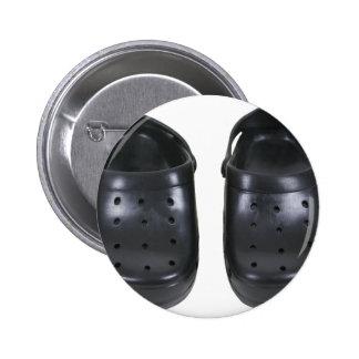 Estorbos negros del caucho pins