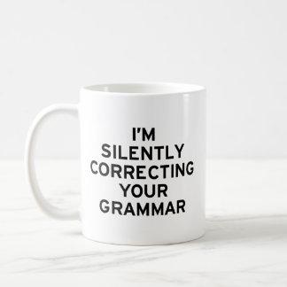 Estoy corrigiendo la gramática taza de café