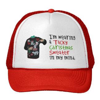 Estoy llevando un suéter pegajoso del navidad en m gorras