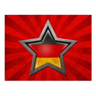Estrella alemana de la bandera con los rayos de la tarjetas postales