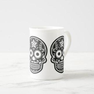 Estrella blanco y negro del cráneo del azúcar taza de porcelana