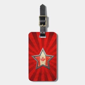 Estrella canadiense de la bandera con los rayos de etiquetas maleta